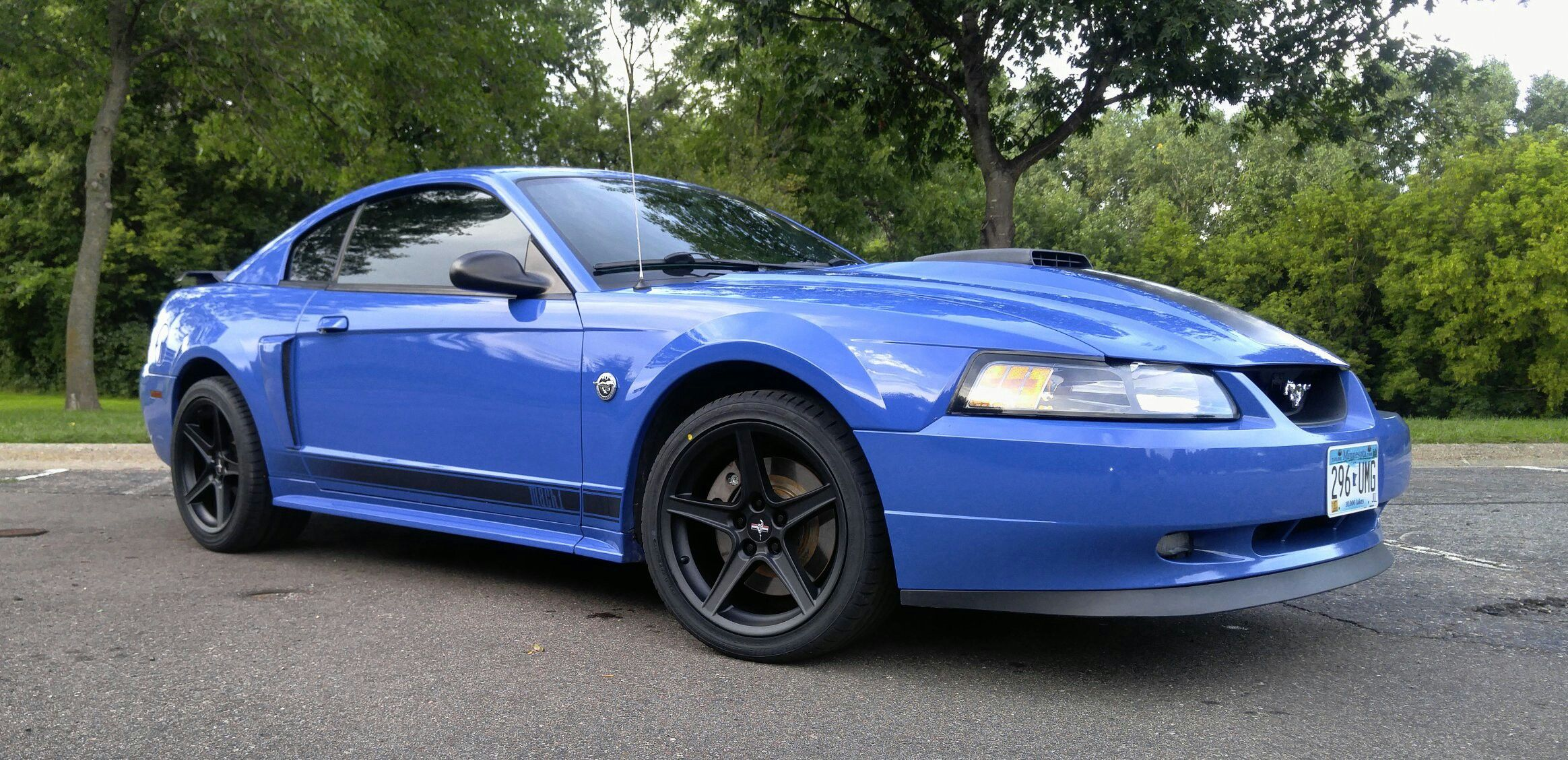 I finally got my hands on a mach 1 2004 azure blue here is my first set of pictures after my initial changes to the car black saleen wheels mustang vinyl