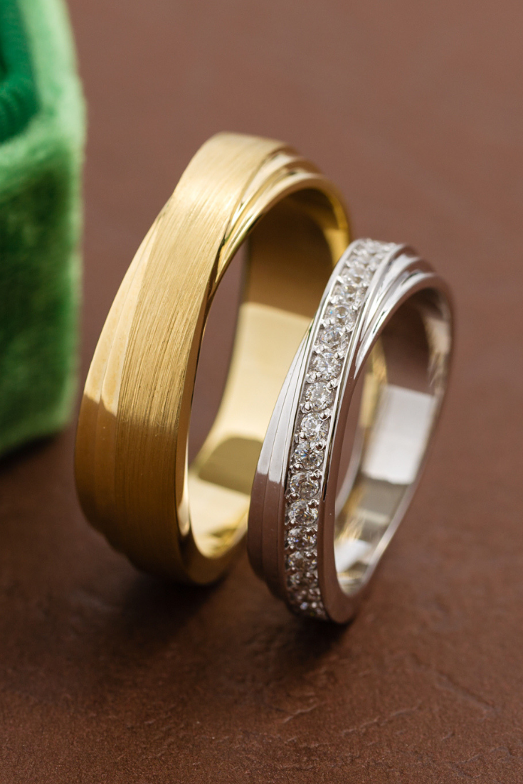 Matching wedding bands with unique twisted design. Gold