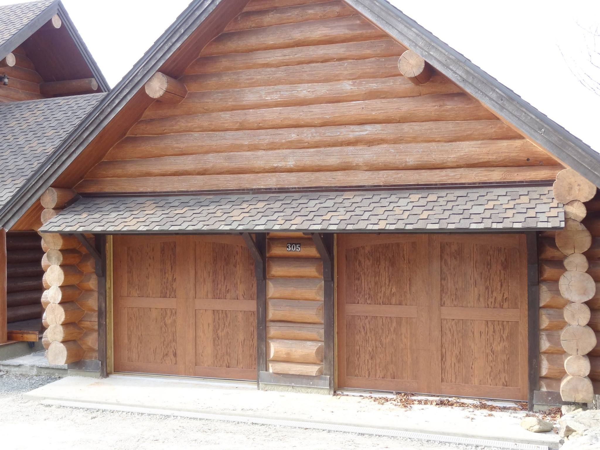 Clopay canyon ridge collection faux wood carriage house for Log cabin style garages