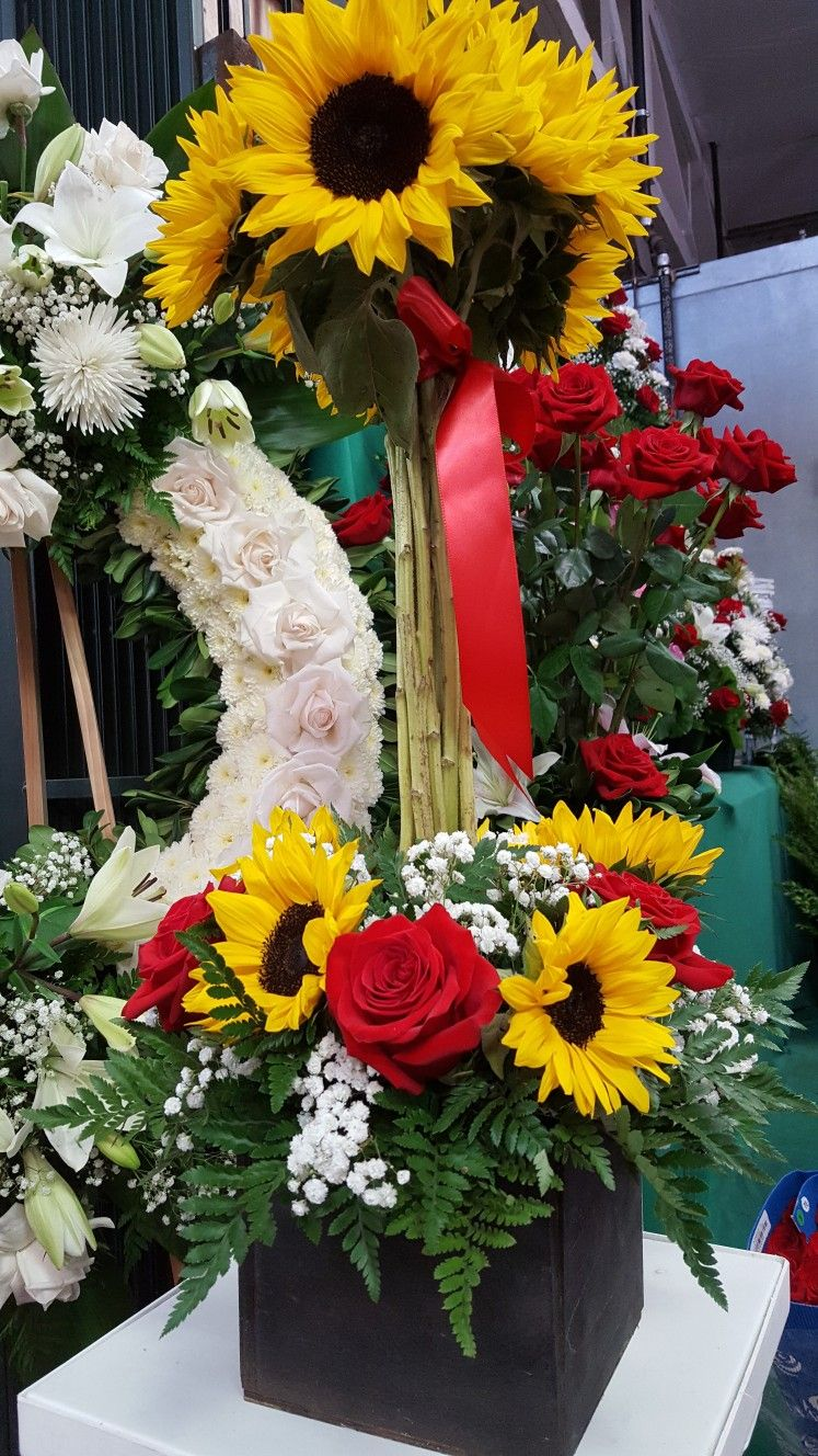 Tribute Flowers Express Sympathy To Families By Honoring The Sunny