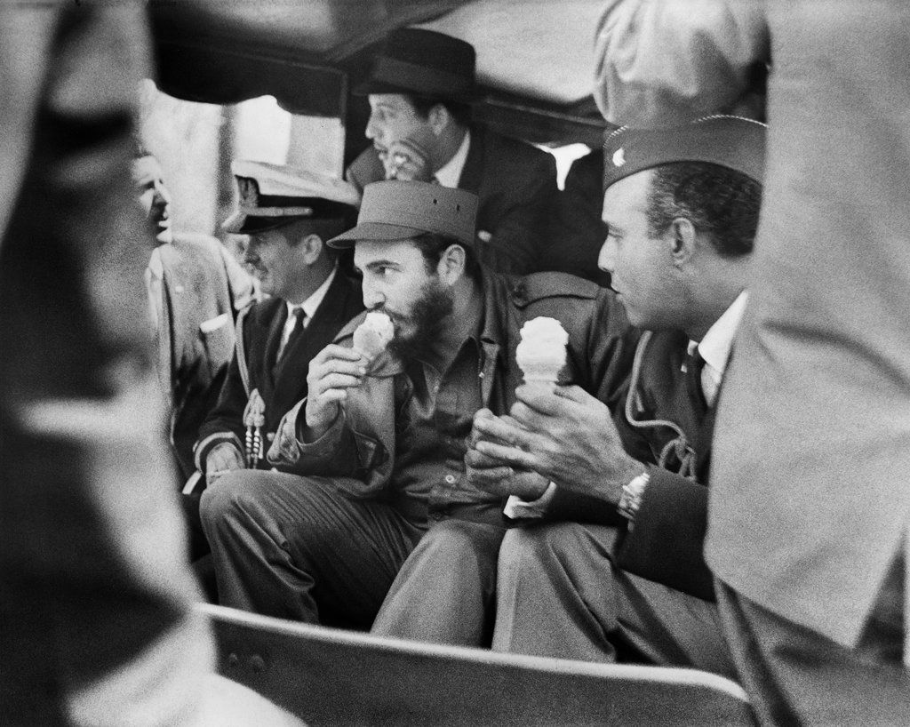 """April 25, 1959: Though Fidel Castro's 1959 visit to New York City included a rally in Central Park at which a bomb-carrying assassin was thwarted, and though the Cuban leader's program included seeding socialist revolution across the Americas, it didn't preclude a break for ice cream, nor a trip to the Bronx Zoo. The Times reported Mr. Castro as saying, after he fed some elephants, that the zoo was """"the best thing New York City has."""" Photo: Meyer Liebowitz/The New York Times"""