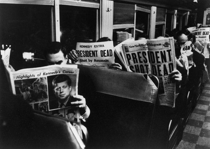 Commuters leaving New York City read of John F. Kennedy's assassination, Nov. 22, 1963.