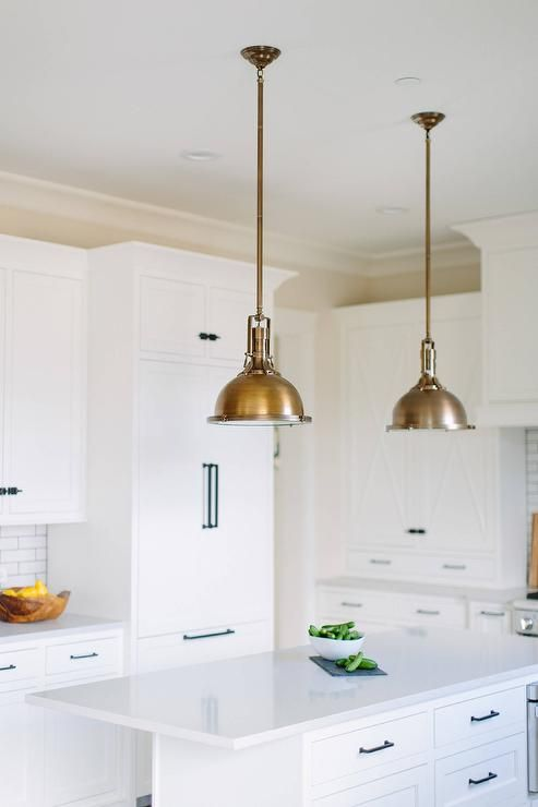 Illuminated By Two Restoration Hardware Harmon Pendants Antique Brass, A  Long White Island Is Accented With Oil Rubbed Bronze Pulls And A White Quau2026