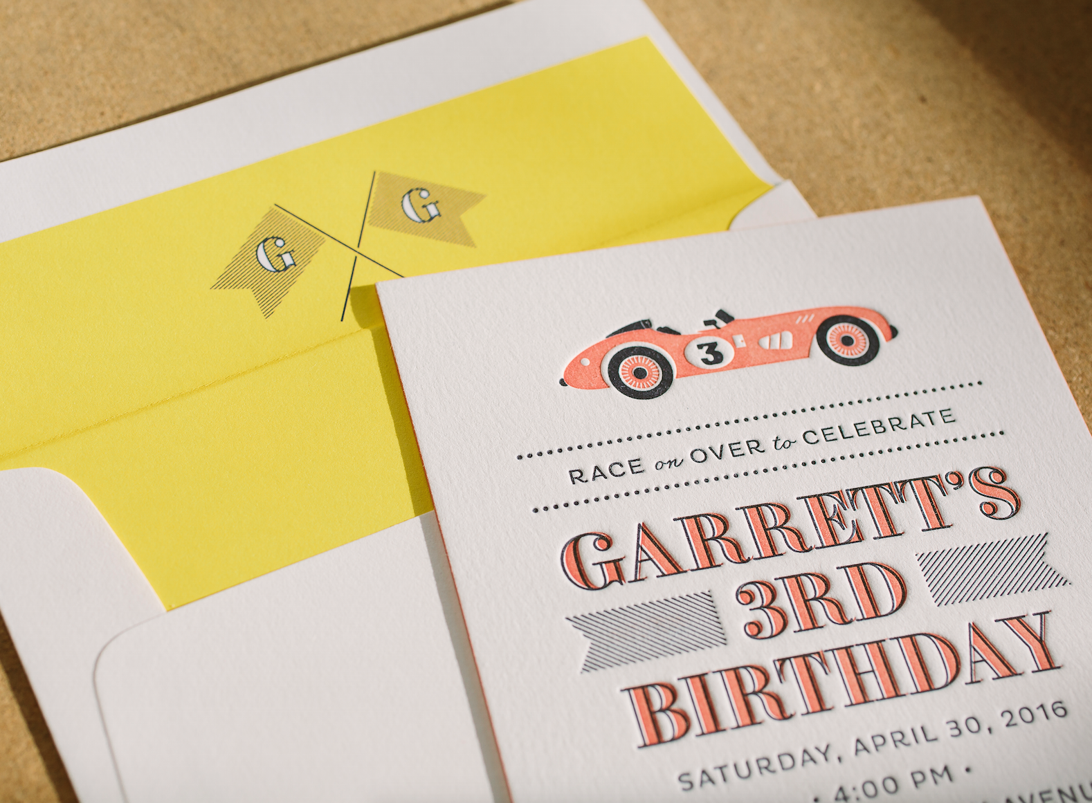 These race car themed letterpress birthday party invitations feature ...