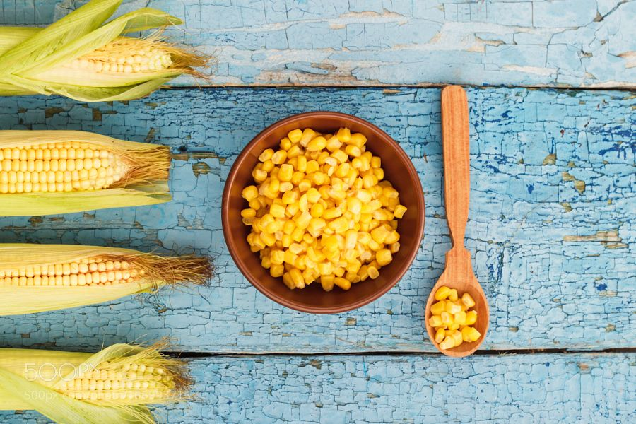 Pic: The line of raw corn and bowl with corn