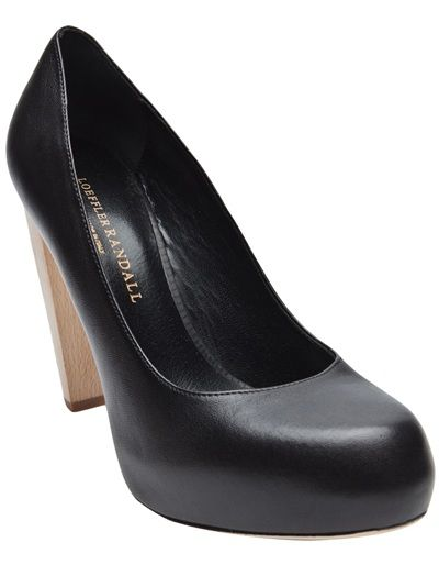 Leather wood heel pump in black from Loeffler Randall. These leather round toe pumps feature a hidden platform and wooden block heel. Platform measures 1