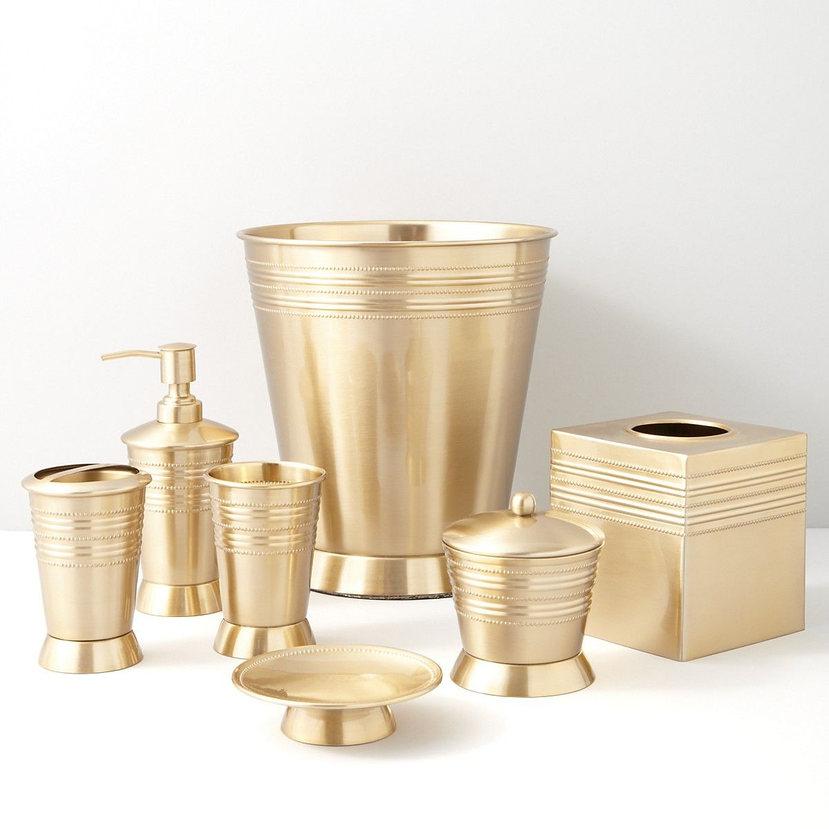 New metallic bead satin brass by paradigm trends bath for Gold bathroom wastebasket