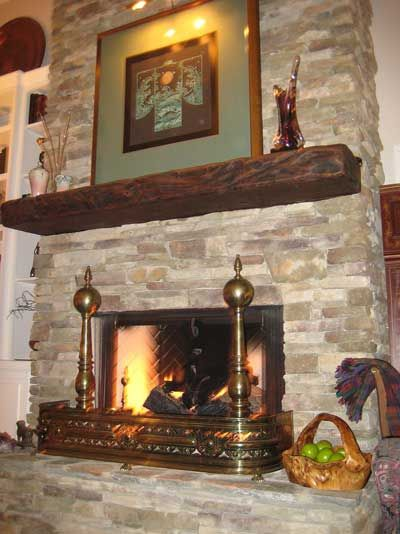 Reclaimed fireplaces and Kitchen with mantle
