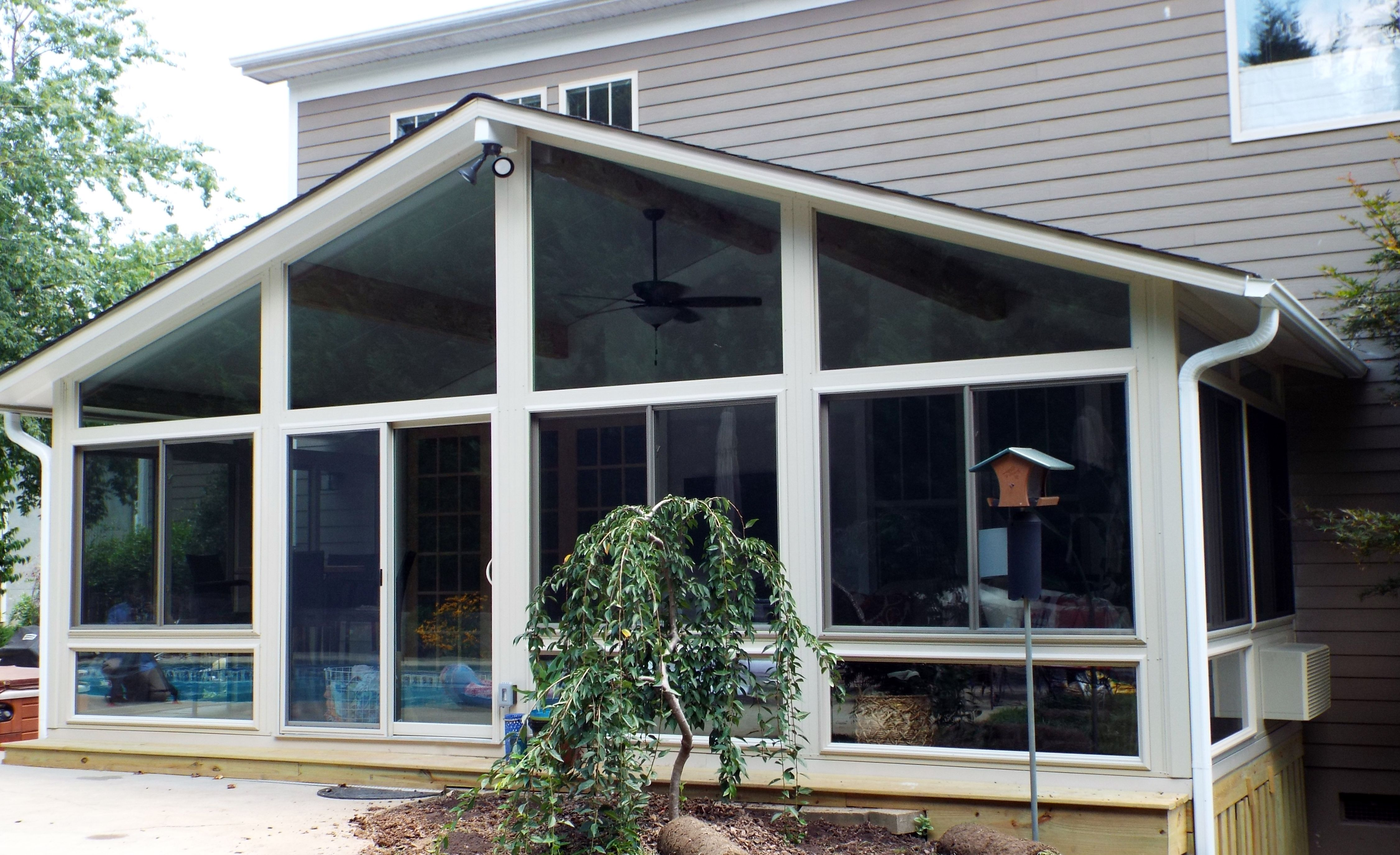 This Amazing Gable Roof All Season Sunroom In Biltmore Lake Nc Overlooks A Pool And Hot Tub Sunroom Backyard Design Porch Enclosures