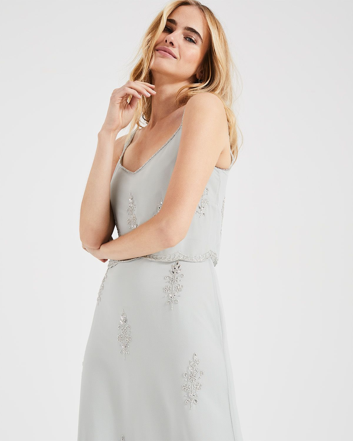 385ac1bdd09a1 A stunning vintage-inspired bridesmaid dress created with delicate beading.  Designed in a flattering