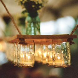 This DIY mason jar chandelier is the perfect wedding decor for rustic dining.
