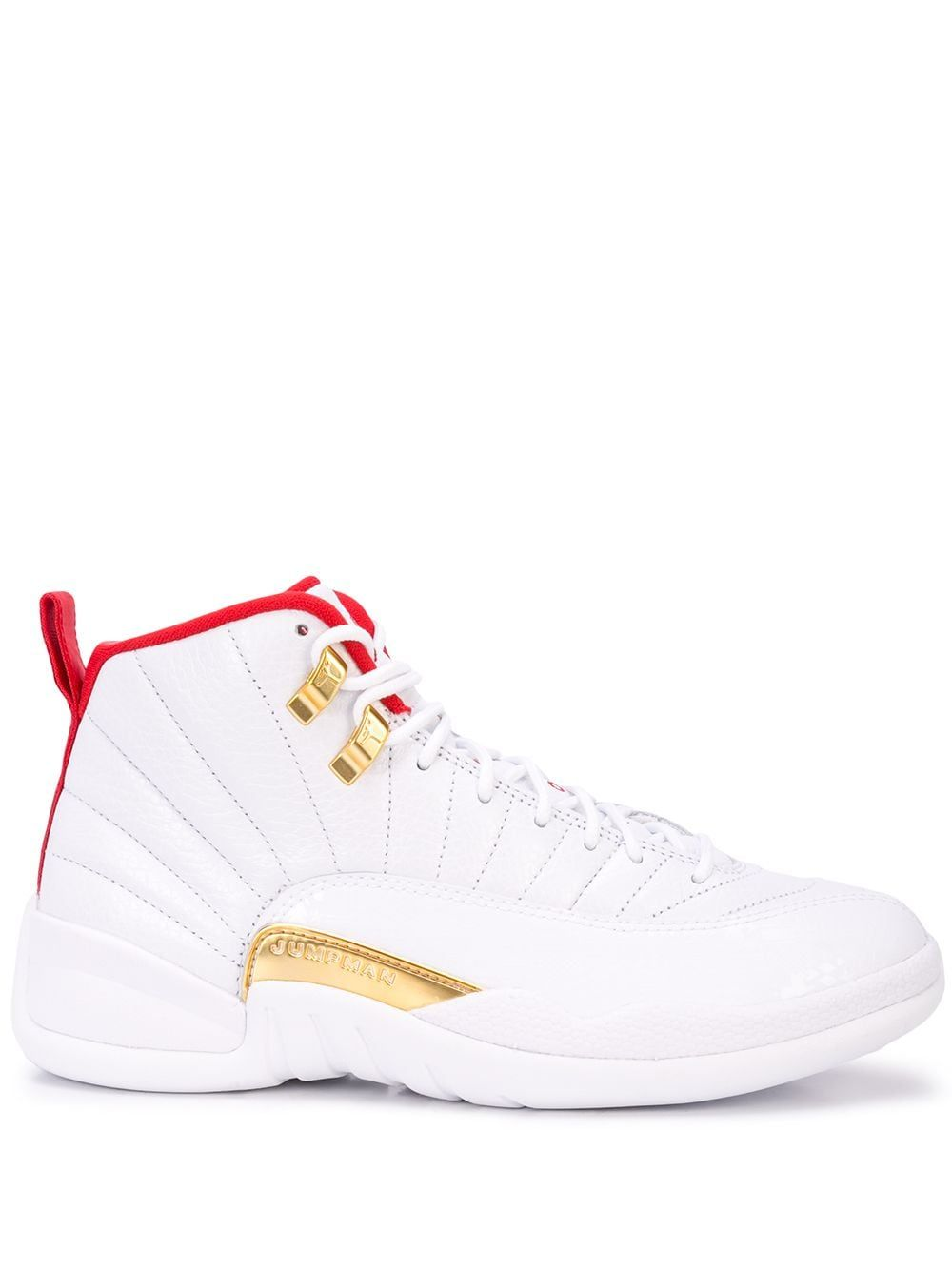 White and red calf leather Air Jordan 12 Fiba from Nike featuring a round toe, a high ankle, a lace fastening, a logo patch at the tongue, a side embossed logo stamp and gold-tone hardware.