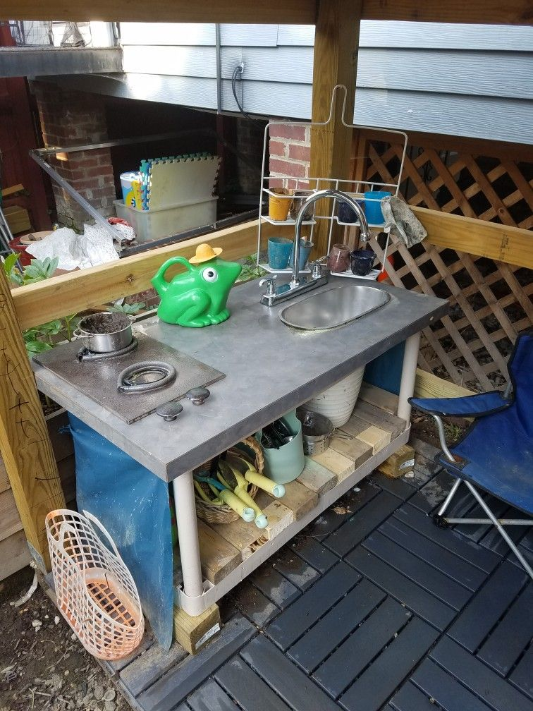 Mud kitchen using recycled materials and free Craigslist