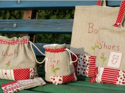 Very cute bags, red and cream patchwork, embroidery, and taupe linen or cotton fabric.