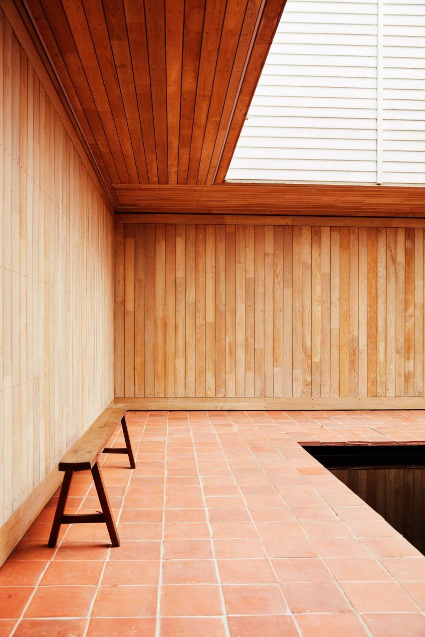 Good Caring Wood By Macdonald Wright Terracotta Tiles Pave The Ground  Surrounding The Reflective Pool, While