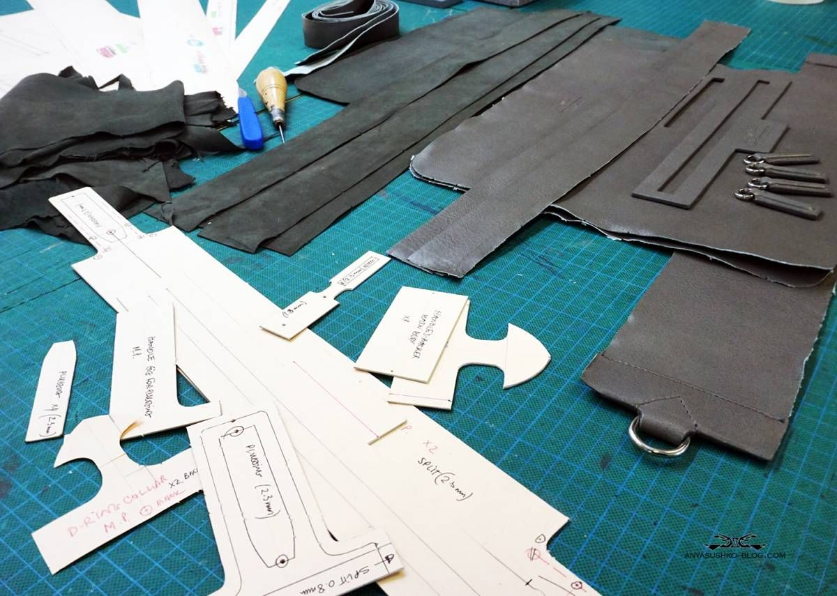 patterns and leather pieces for a bespoke men's bag