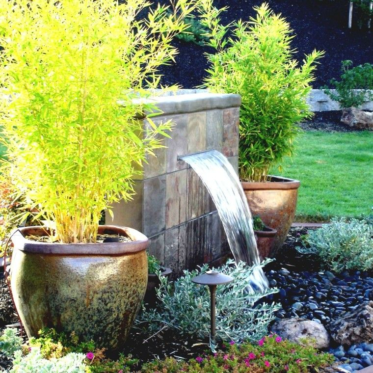 Fuente cascada con piedras negras amandix pinterest for Cascadas de piedra para jardin