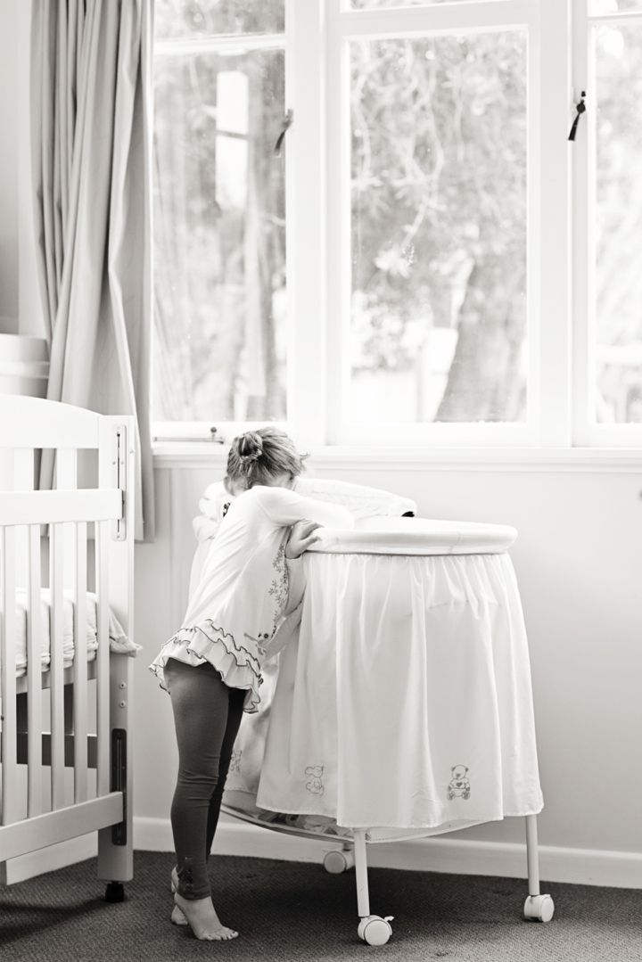 Sadie and Co: Lifestyle Maternity session. Big sister in the nursery