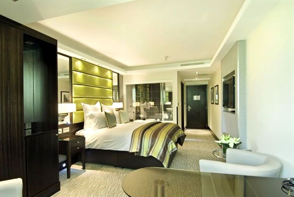 Alluring luxury boutique hotel bedroom hospitality for Luxury hotel room interior design