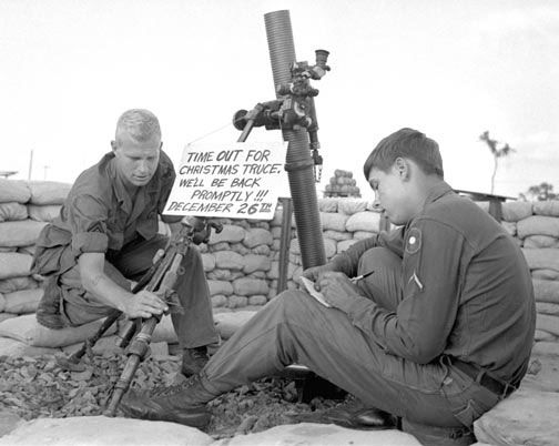 South Vietnam, December, 1967: 9th Infantry Division soldiers Staff Sgt. William Dowell of Orange Lake, N.J., and Pfc. Ronald Hull of Waupun, Wis., relax next to an idle mortar.