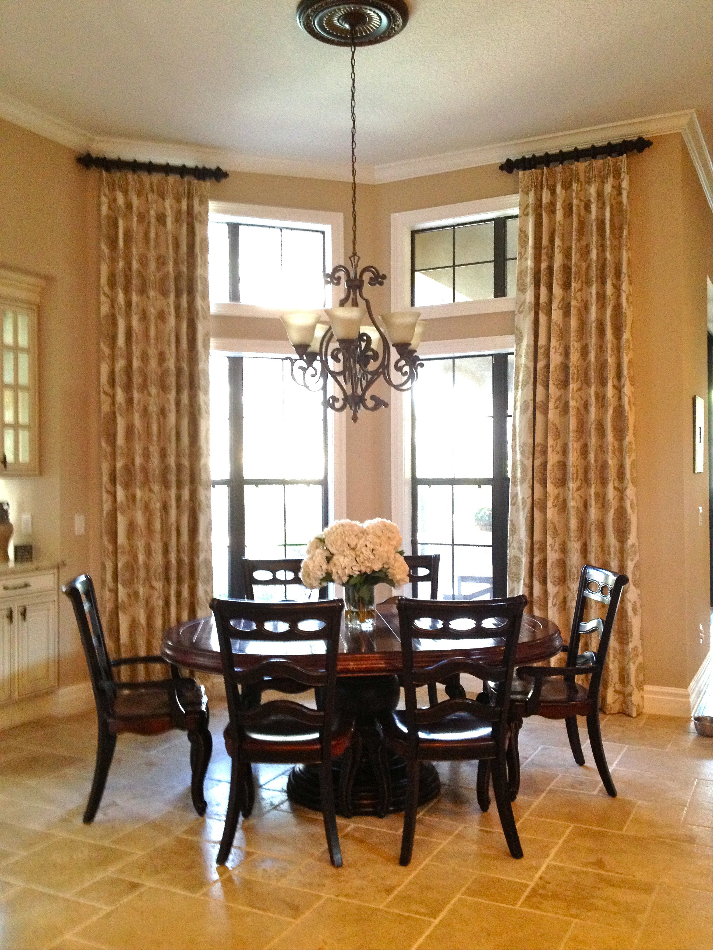 Window dressing ideas for arched windows  the fabric used to create these drapes is so pretty a cream linen