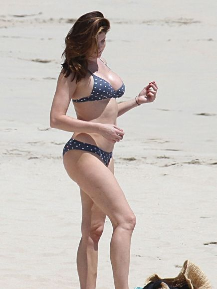 With her slim body and Regular brown hairtype without bra (cup size ) on the beach in bikini