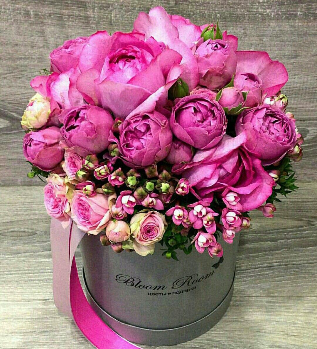 A beautiful floral arrangement of fuschia roses. Flower