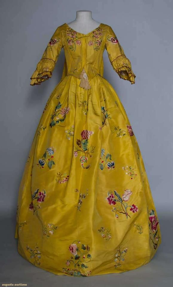 Polychrome embroidered robe a la francaise, 1765.  Goldenrod silk faille, tour de force embroidered exotic florals worked in various stitches & incorporating silk fabric appliques in larger blossoms, also small bird & insect embroidery, apron front skirt, baleen stays in homespun linen & wool bodice lining.