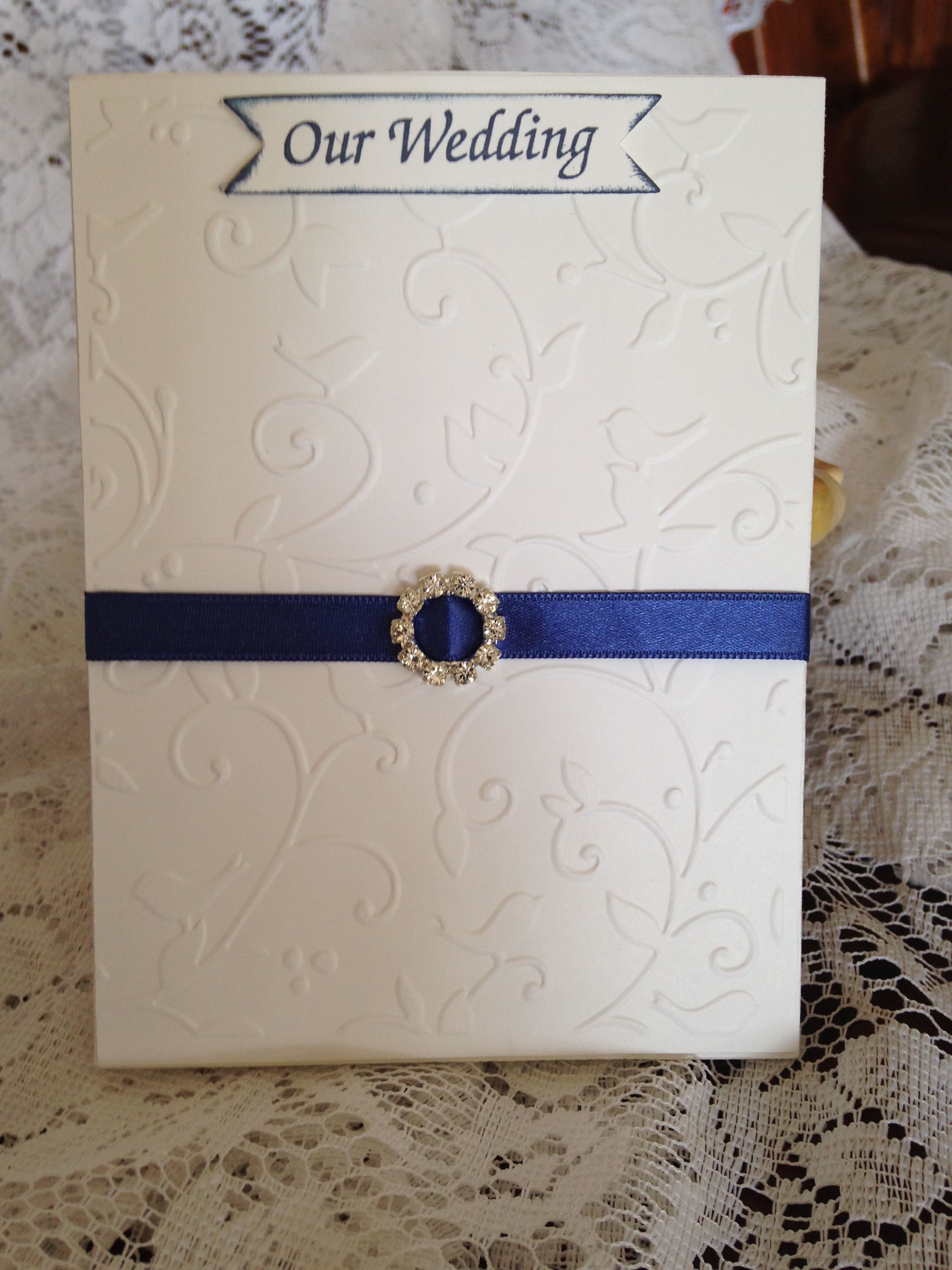 White embossed fold out Wedding Invitation. Blue Ribbon with silver ...