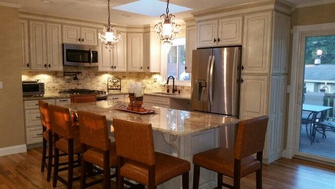 Savannah hazelnut glaze cabinets with travertine tiles for ...