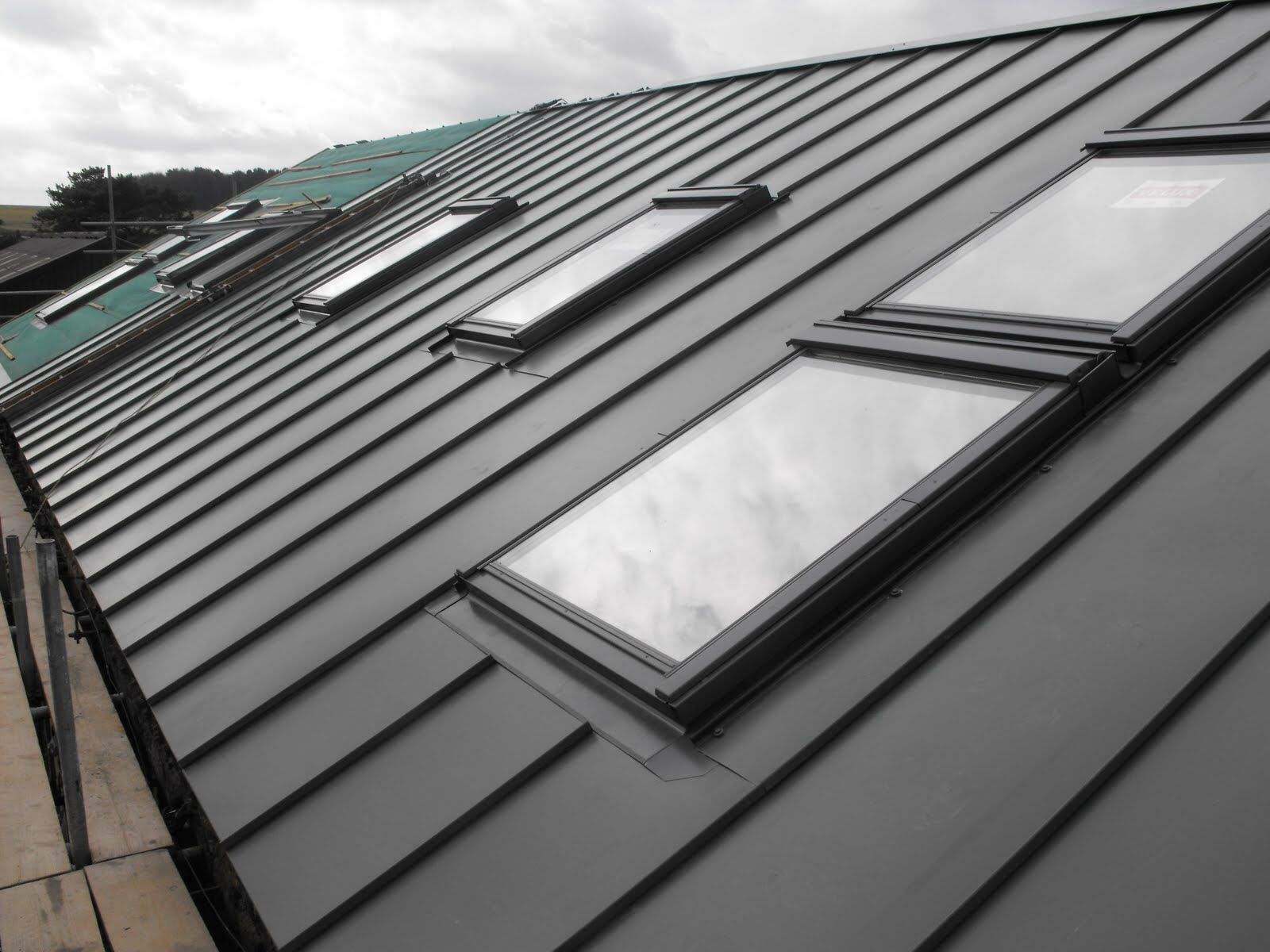 Metal roof with velux window home exteriors pinterest for Velux cladding kit