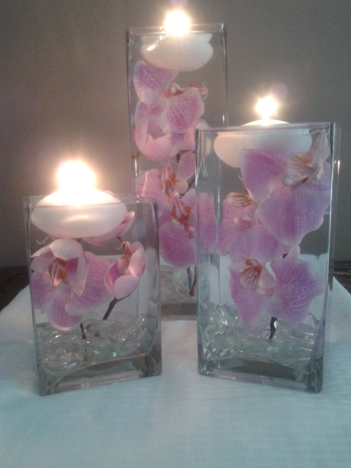 A set of three square vases with purple orchids floating in water a set of three square vases with purple orchids by wreathsbydiane reviewsmspy