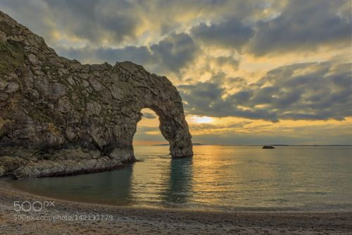 Arch Enemies by rgwphotos  sea sunset water beach sun clouds ocean rocks beautiful sand stone dorset \ Durdle Door Arch Enemies