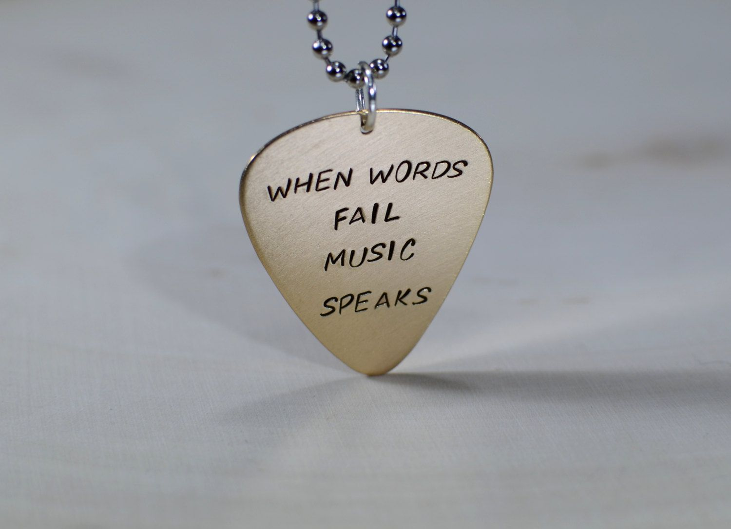 When words fail music speaks 14k yellow gold guitar pick pendant when words fail music speaks 14k yellow gold guitar pick pendant mozeypictures Image collections