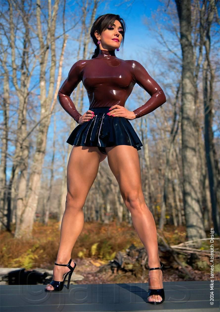 Excellent female muscular legs in a skirt for