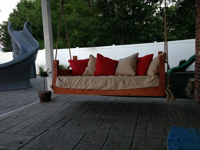 Swinging porch bed. My hubby made this!
