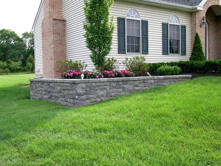 A retaining wall is used on this project to level the ...