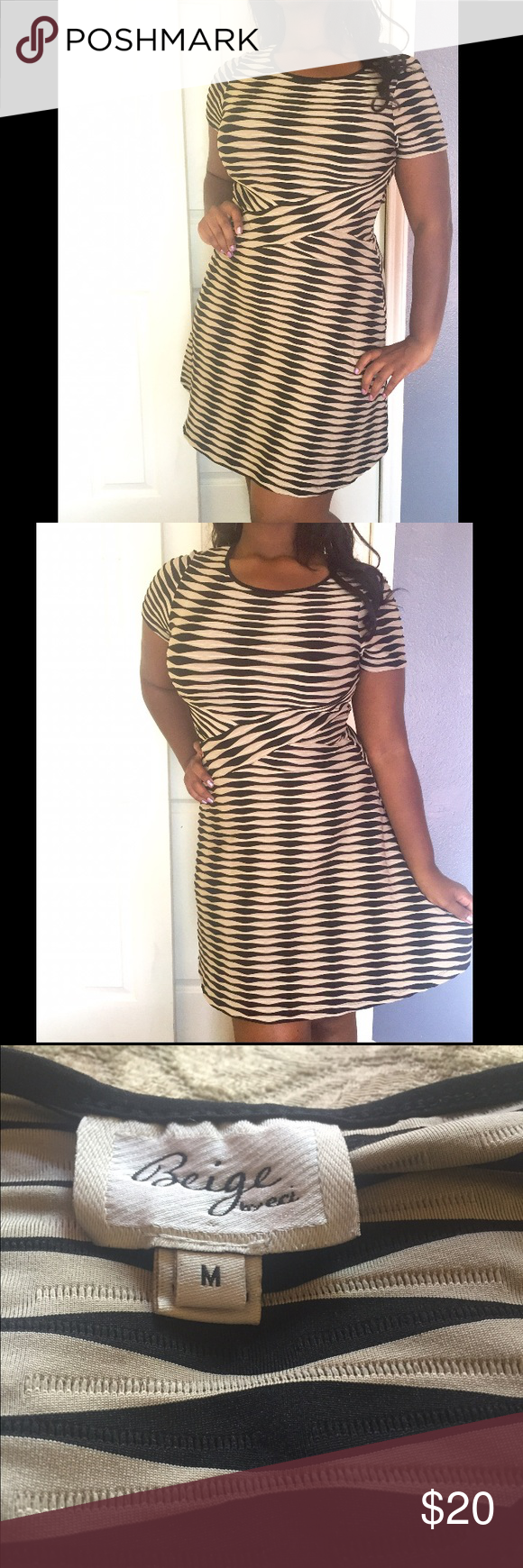 Tan and black dress Tan and black dress. Short sleeves. Stretchy, textured fabric. Size M Beige Dresses Midi