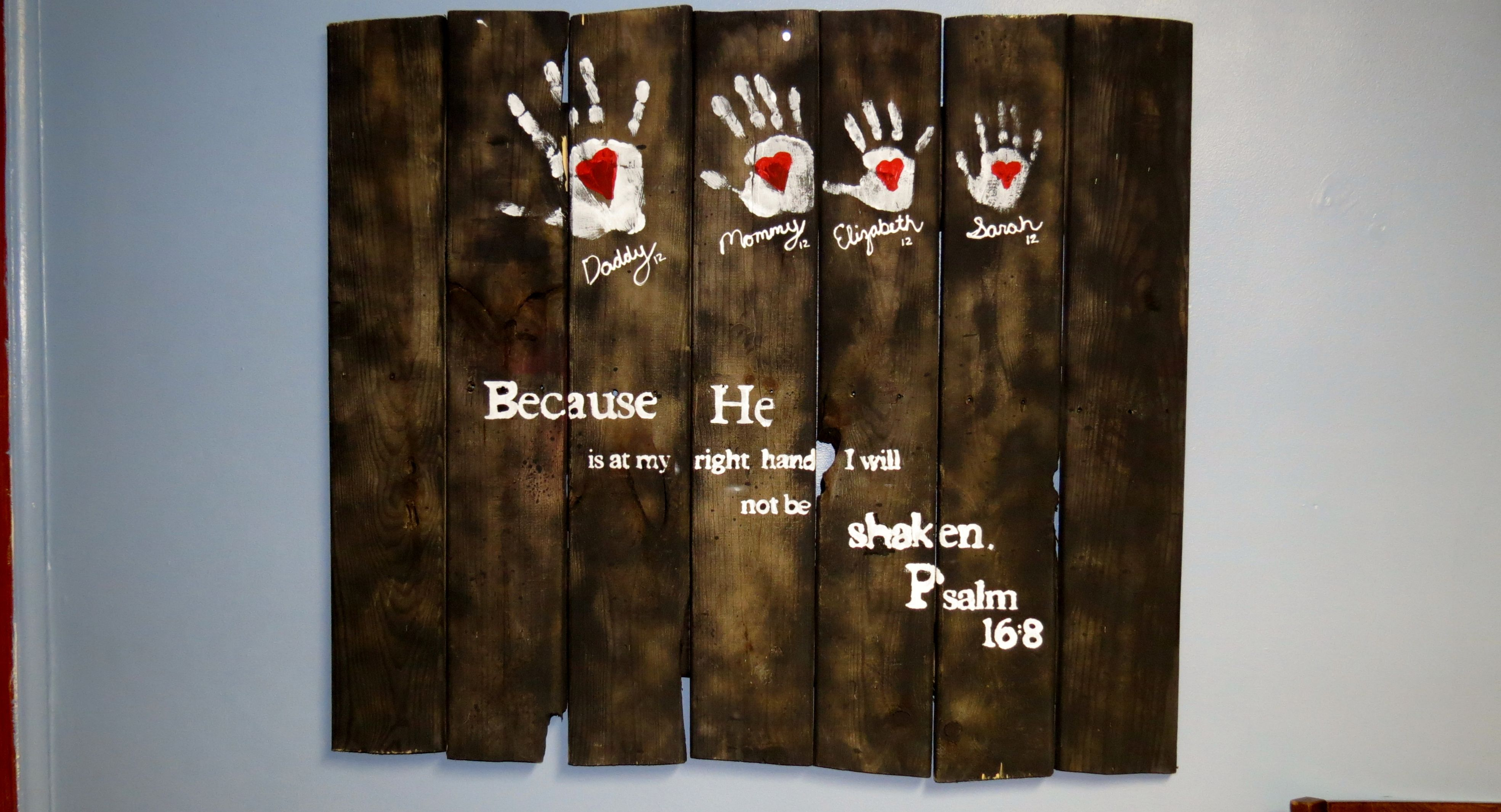 Pallet Art - Family hand prints on painted pallet wood.