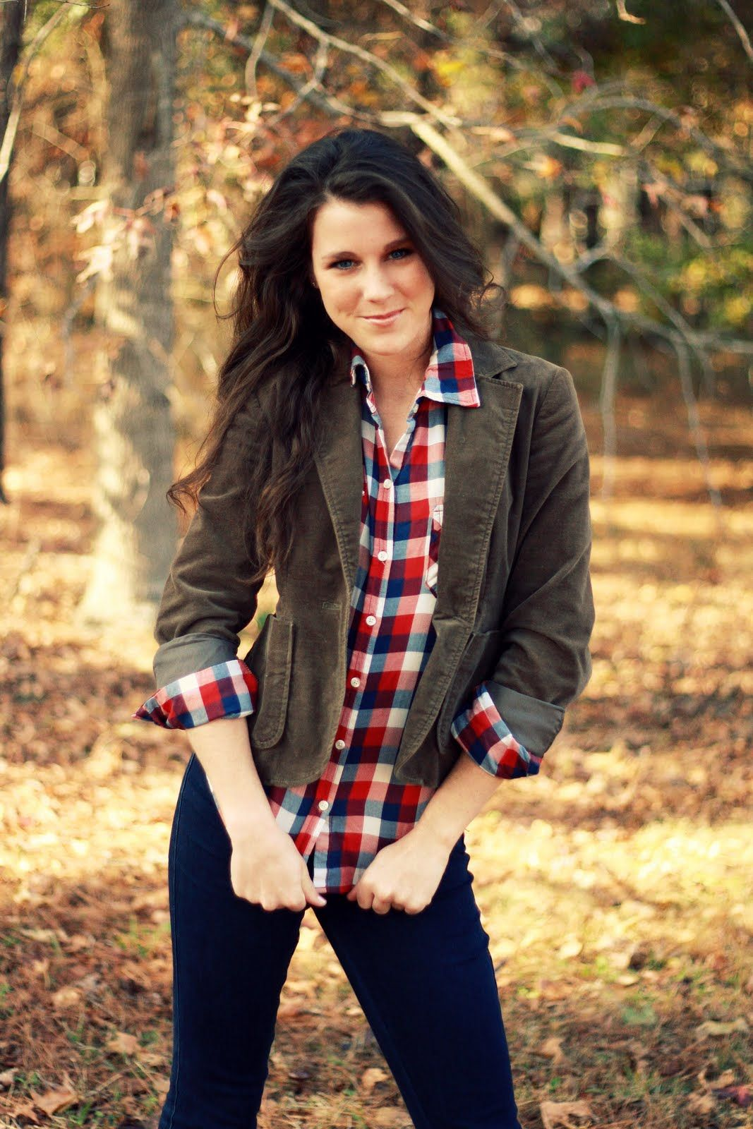 Olive green blazer over red, white, and a blue plaid, and her hair! cute. **** I dont know what it is but this outfit makes me excited for the fall ****