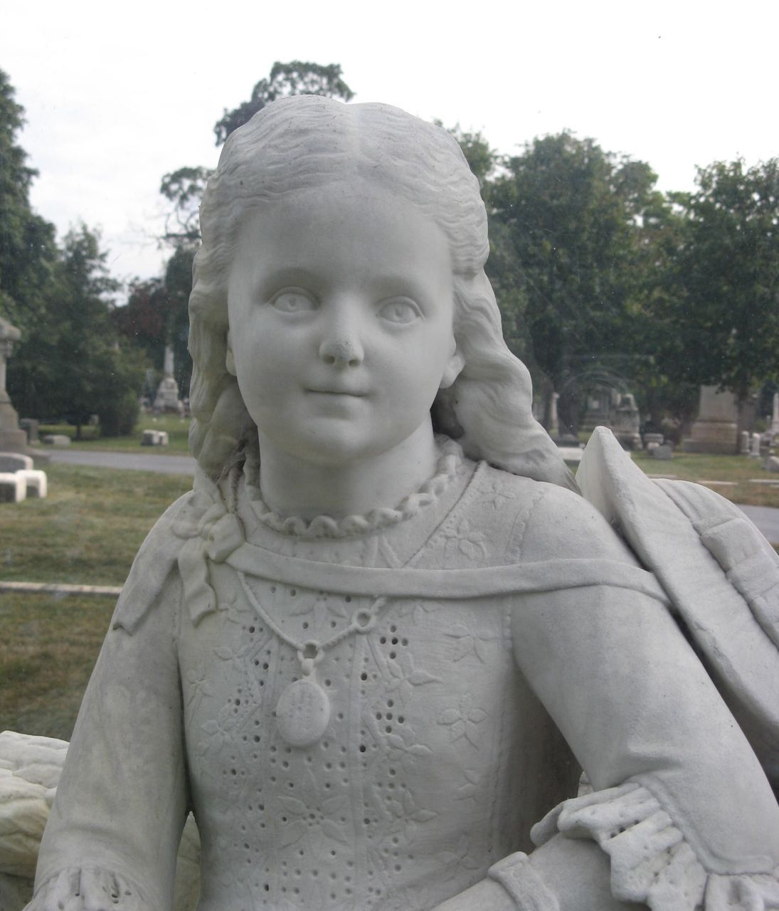 "This grave with the statue of a young girl is marked 'Inez"" and ""Daughter of J.N. & M.C. Clarke. Born Sept. 20, 1873, Died Aug. 1, 1880.""   Burial:  Graceland Cemetery  Chicago  Cook County  Illinois, USA"