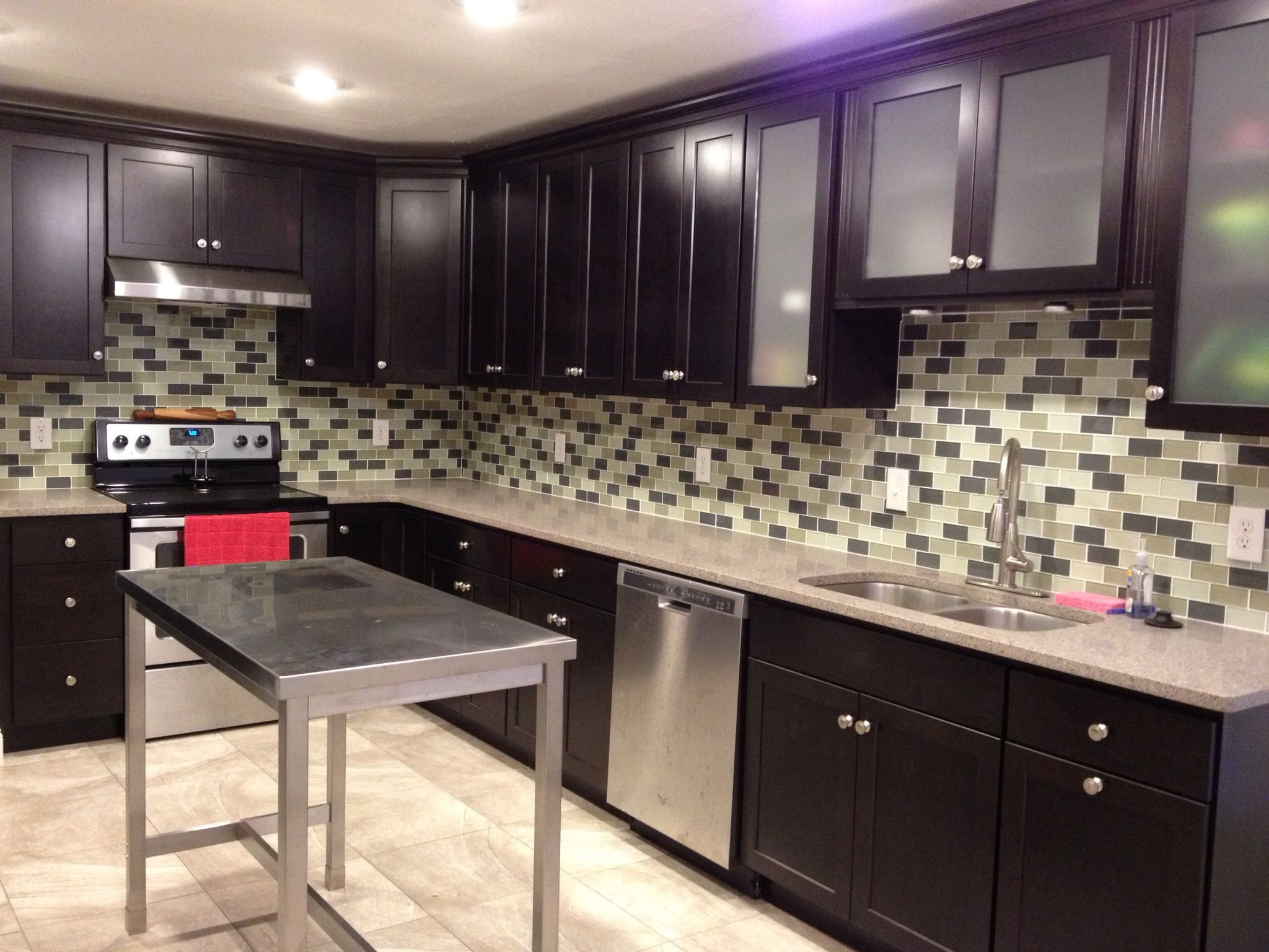 Java kitchen cabinets with subway tile backsplash and stainless ...