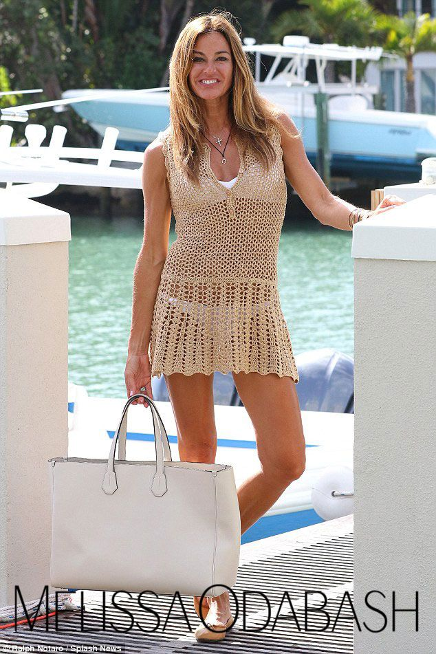 be8b723ea8 Kelly Bensimon in Melissa Odabash 'Rosie' gold crochet dress ...