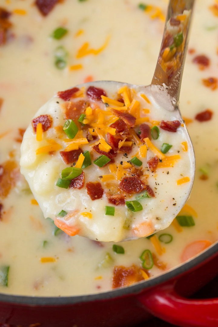 My all time favorite potato soup recipe! This easy, homestyle soup is deliciously rich and creamy and loaded with hearty potatoes. And I highly recommend the toppings, they add so much flavor! #potatosoup #soup #dinner #recipe