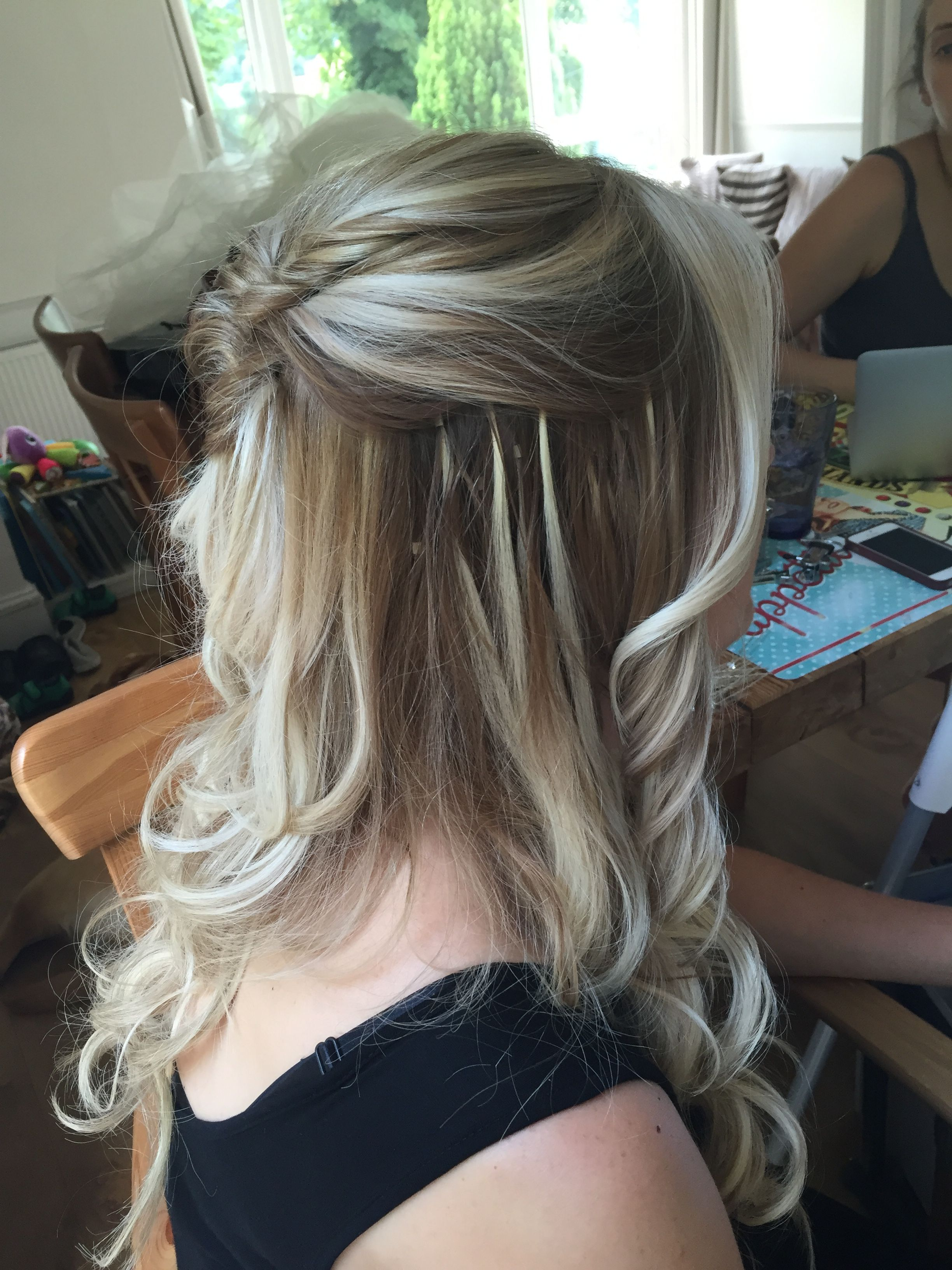Twisted half up half down soft curls bridal hairstyle