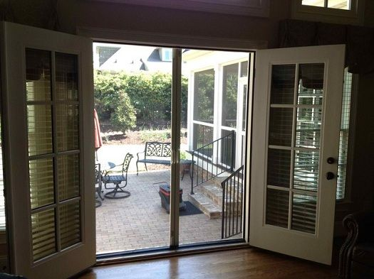 French patio doors with screens doors for cool weather for Double entry storm doors