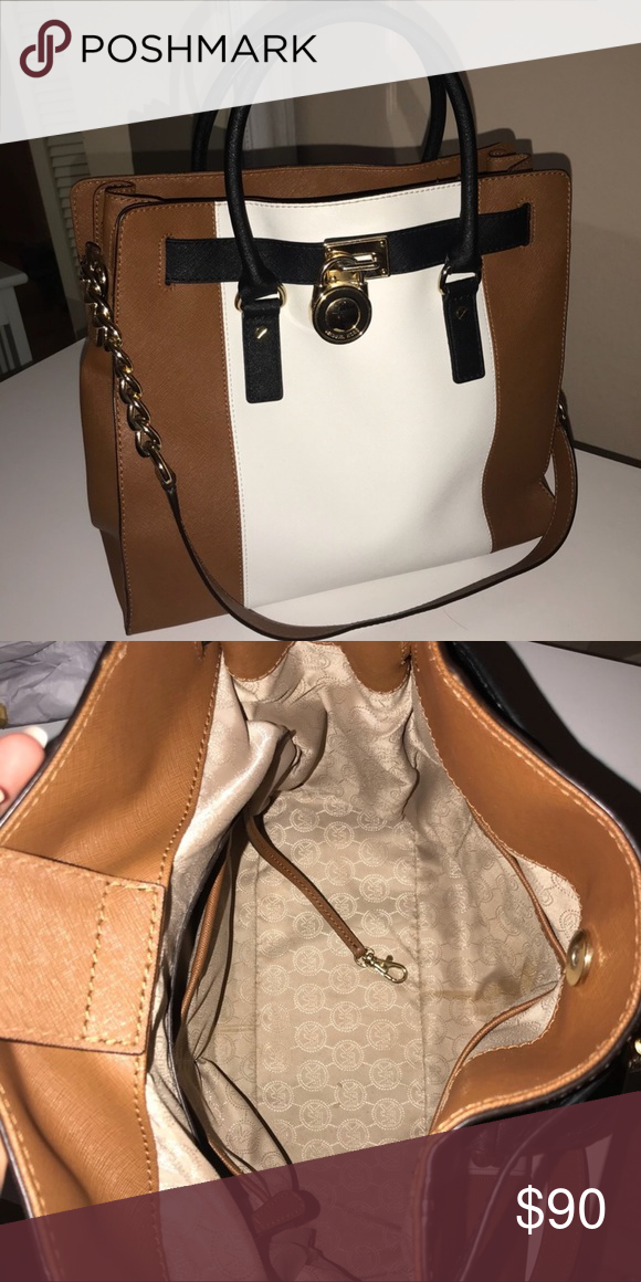 eb9df25168b3 Micheal Kors Purse Black, white, and tan MK purse with gold accents USED  Stain on the inside fabric Reasonable offers accepted Michael Kors Bags  Shoulder ...
