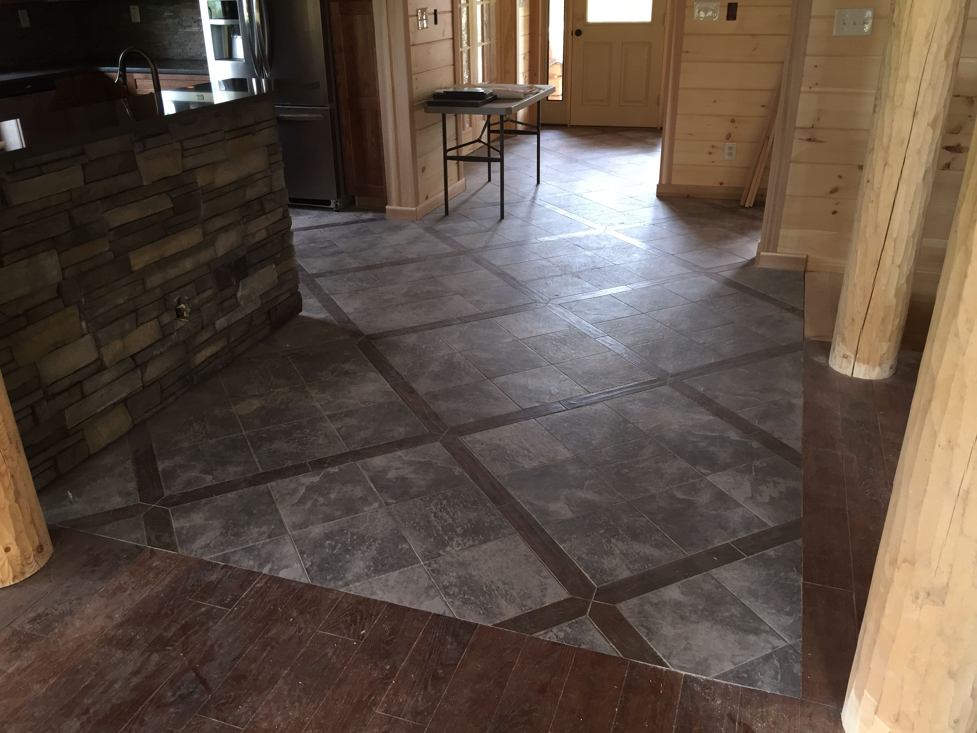 3 4 Inch Wideplank Oak Hardwood Floors With A Faux Slate Porcelain Tile Throughout The Log Home Adds To Endurance Of Longevity This