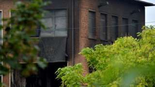 """Image copyright                  Reuters Image caption                                      """"Significant"""" damage was caused to the building                                Five people have been arrested over a fire at crime laboratories in Brussels that officials believe may have been started to destroy forensic evidence. Prosecutor's spokeswoman Ine Van Wymersch said a car rammed through fences, leading to an explosion and a la"""