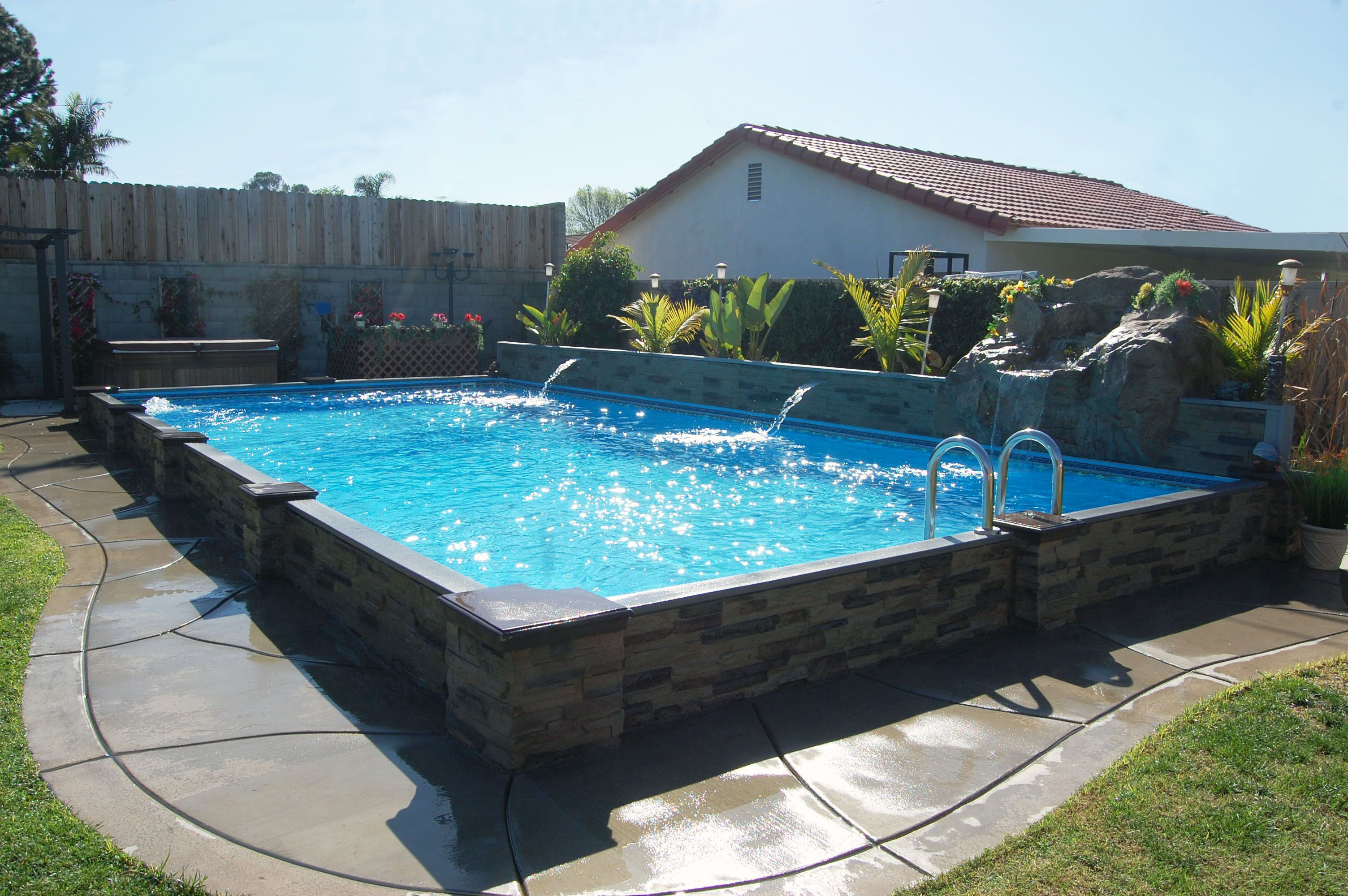 This exlusive Islander pool is 14' x 28' with a rock waterfall and 2